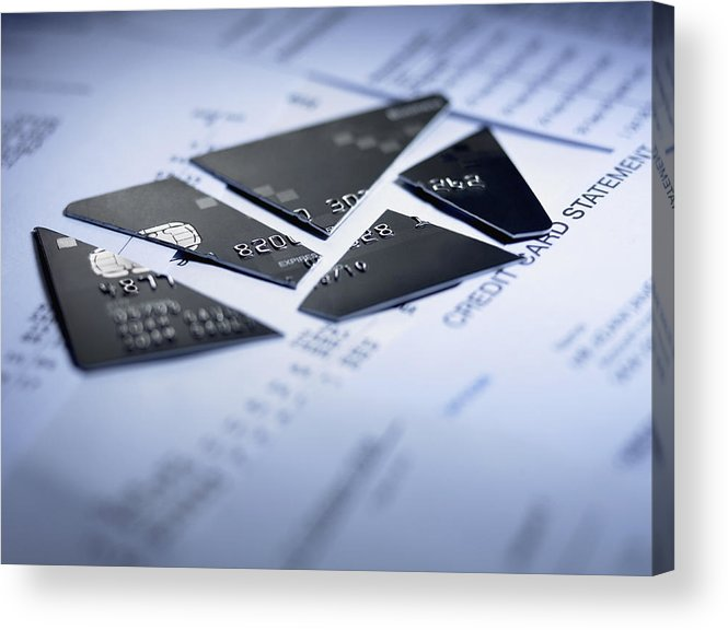 Debt Acrylic Print featuring the photograph Close up of cut pieces of credit card by Adam Gault