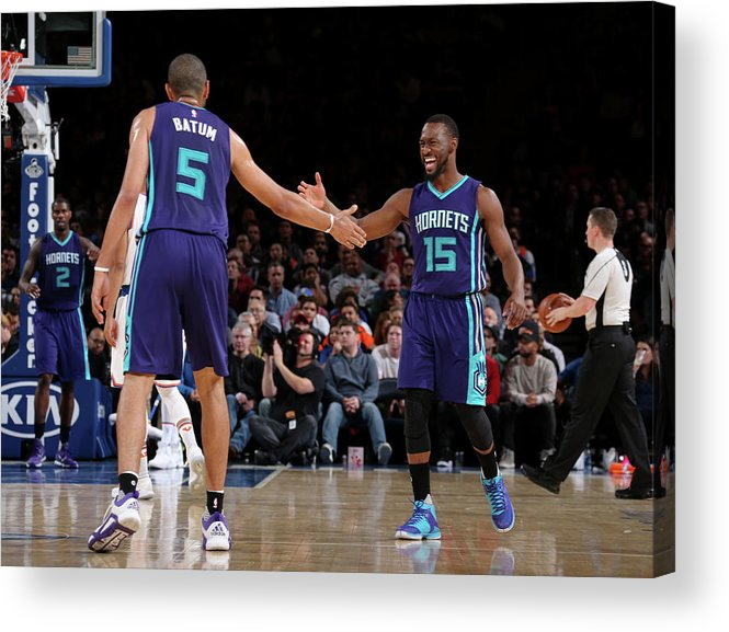 Nicolas Batum Acrylic Print featuring the photograph Nicolas Batum and Kemba Walker by Nathaniel S. Butler