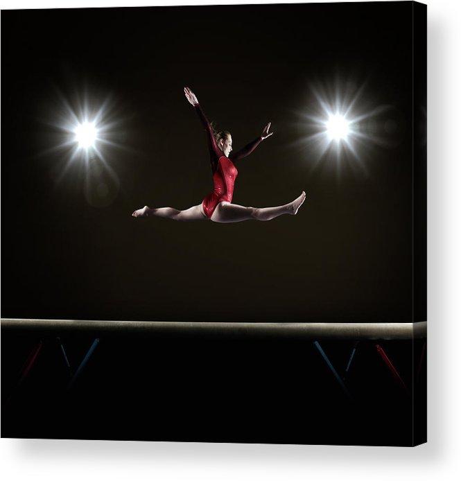 Human Arm Acrylic Print featuring the photograph Female Gymnast Doing Mid Air Splits by Mike Harrington