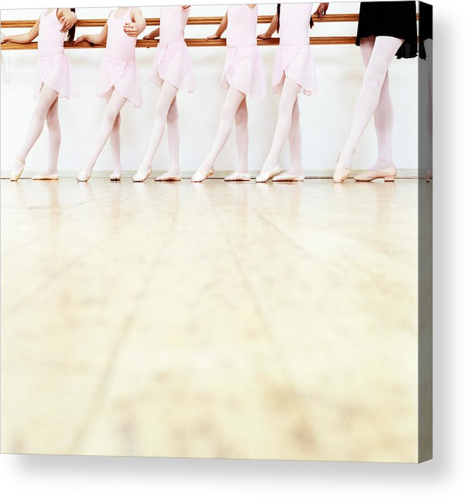 Ballet Dancer Acrylic Print featuring the photograph Low Section View Of A Line Of Young by Digital Vision.