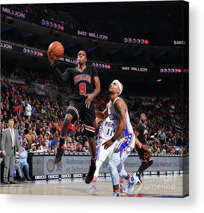 Nba Pro Basketball Acrylic Print featuring the photograph Rajon Rondo by Jesse D. Garrabrant