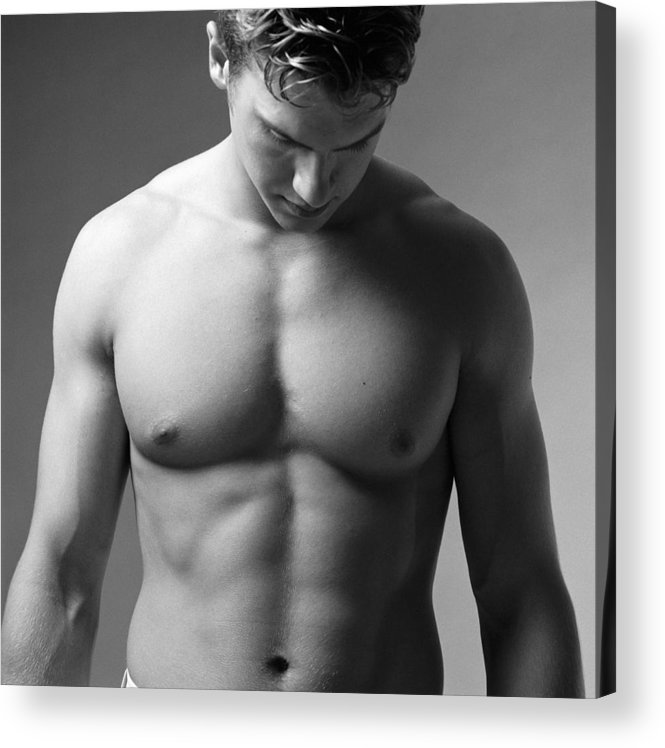 Adolescence Acrylic Print featuring the photograph A Bare Torso Of A Muscular Caucasian Male by Photodisc