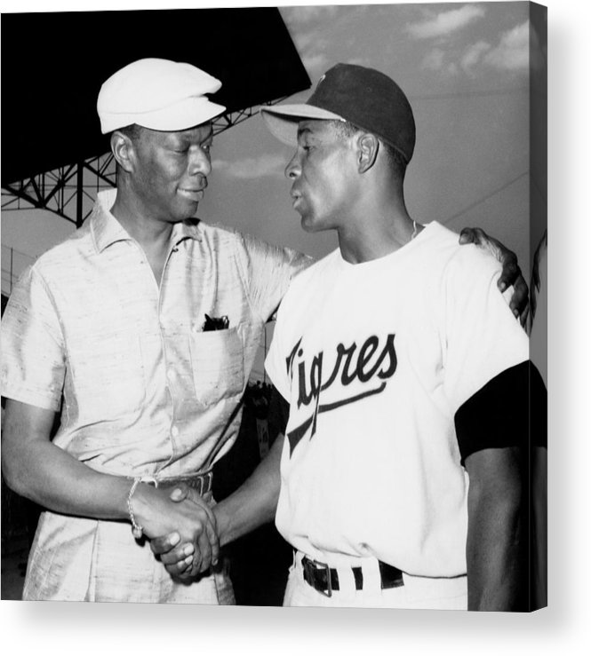 1950-1959 Acrylic Print featuring the photograph Nat King Cole And Minnie Minoso by Michael Ochs Archives