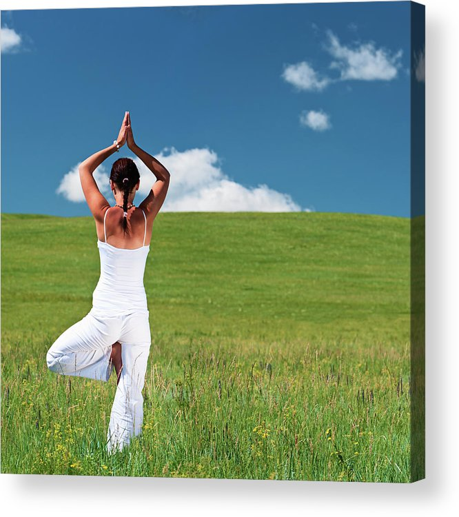 Scenics Acrylic Print featuring the photograph Young Woman Practicing Yoga by Hadynyah