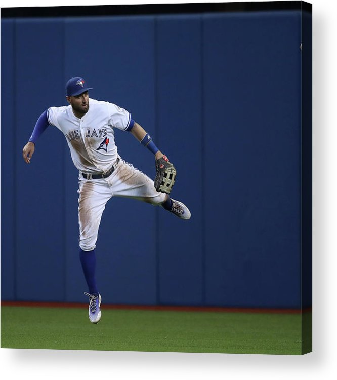 People Acrylic Print featuring the photograph Kevin Pillar and Jonathan Schoop by Tom Szczerbowski