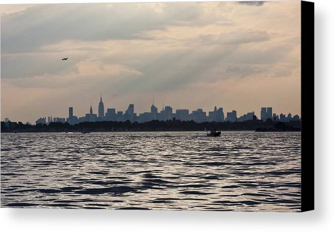 Cityscape Canvas Print featuring the photograph Manhattan Skyline From Channel by Arthur Sa