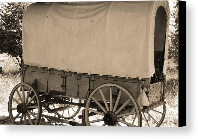 Old Covered Wagon Out West Canvas Print featuring the photograph Old Covered Wagon Out West by Dan Sproul