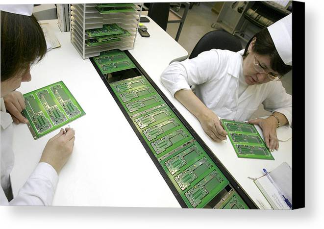 Electronic Circuit Canvas Print featuring the photograph Printed Circuit Board Assembly Work by Ria Novosti