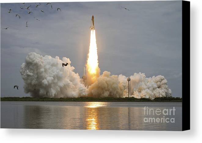 Atlantis Canvas Print featuring the photograph Space Shuttle Atlantis Lifts by Stocktrek Images