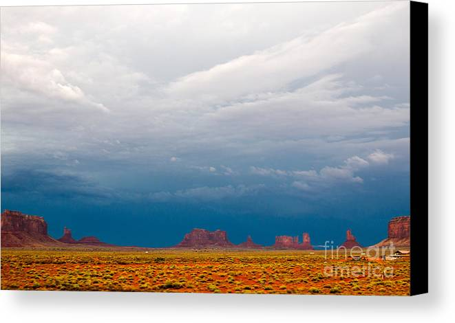 Monument Valley Canvas Print featuring the photograph Blue Sky by Robert Popa