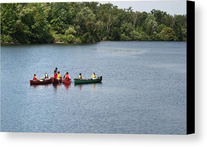 Canoe Canvas Print featuring the photograph Canoes On Lake by Blink Images