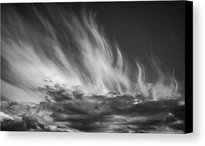 Sky Canvas Print featuring the photograph Clouds - Flame Shape - Black And White by Krzysztof Dac