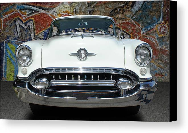 Cars Canvas Print featuring the photograph Old Oldsmobile by Nancy Aurand-Humpf