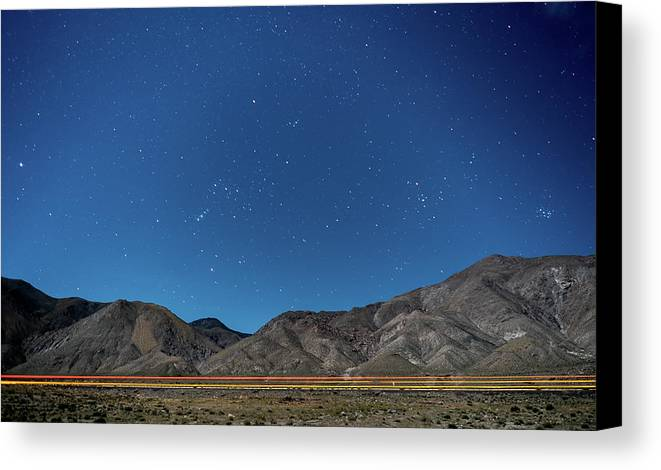 Walker Lake Canvas Print featuring the photograph Semi's In The Night by Ryan Kelehar