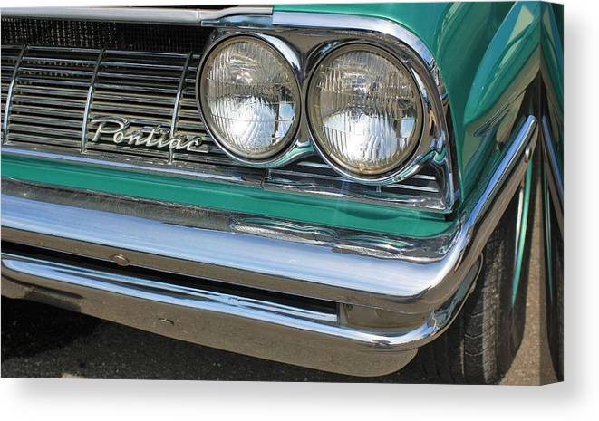 Auto Canvas Print featuring the photograph 1961 Pontiac Catalina Grille With Headlights And Logo by WHBPhotography Wallace Breedlove