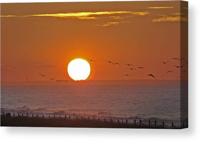 Sunset Canvas Print featuring the photograph Oak Island Lighthouse by Robert Ponzoni