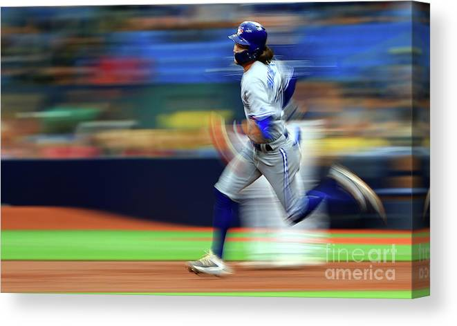People Canvas Print featuring the photograph Toronto Blue Jays V Tampa Bay Rays by Mike Ehrmann