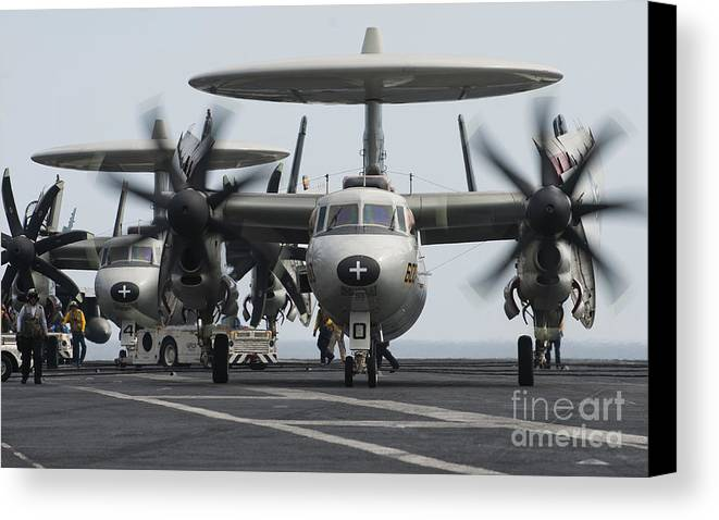 Taxiing Canvas Print featuring the photograph An E-2c Hawkeye Aircraft On The Flight by Stocktrek Images