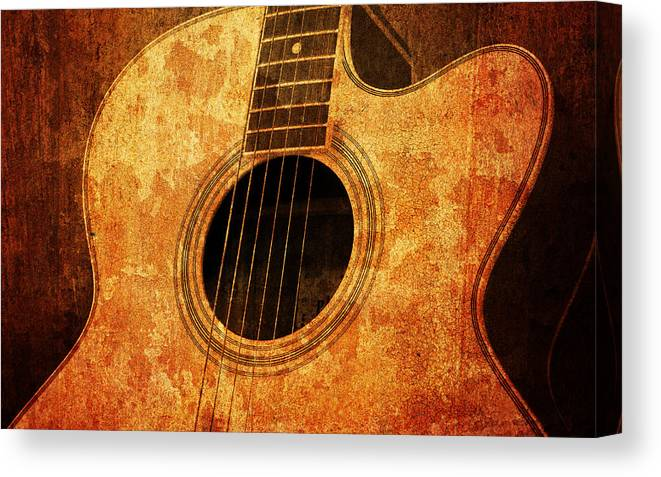 Aged Canvas Print featuring the mixed media Old Guitar 1 by Nattapon Wongwean
