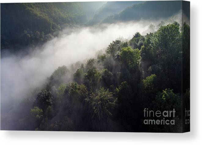 Above Canvas Print featuring the photograph Fantastic Dreamy Sunrise On Foggy Mountains by Mariusz Prusaczyk