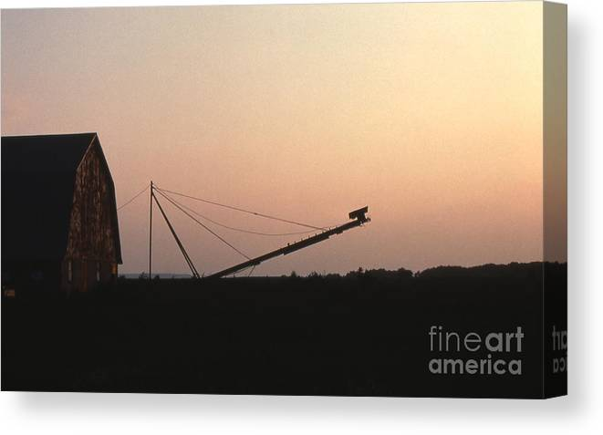 Barn Canvas Print featuring the photograph Barn At Sunset by Timothy Johnson