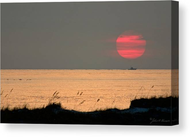 Sun Set Canvas Print featuring the photograph Fishing Boat Under Setting Sun by John Harmon
