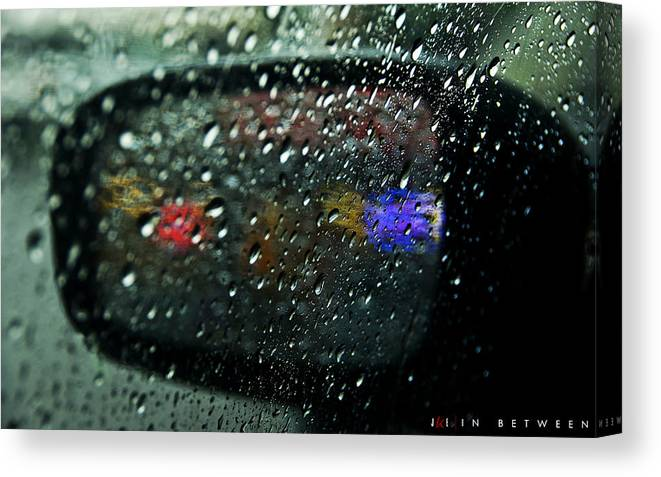 Sideview Mirror Canvas Print featuring the photograph In Between by Jonathan Ellis Keys