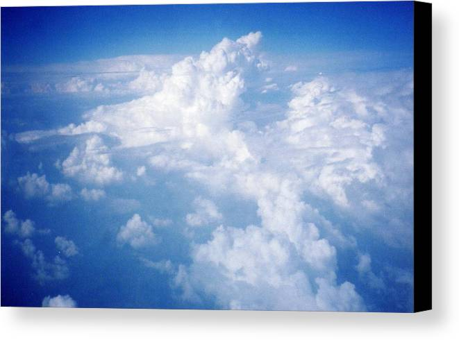 Clouds Canvas Print featuring the photograph Above The Clouds 1 by Michele Kaiser