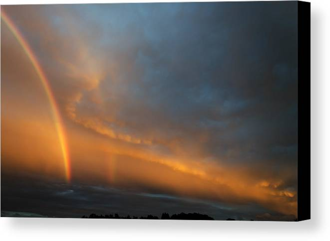 Rainbow Canvas Print featuring the photograph Ethereal Clouds And Rainbow by Greg Reed