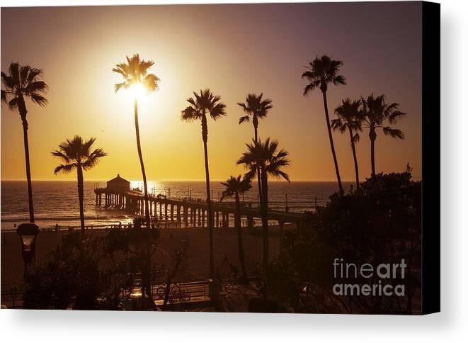 Manhattan Beach Pier Canvas Print featuring the photograph Manhattan Beach At Sunset by Stella Levi