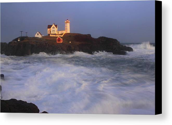 Maine Canvas Print featuring the photograph Nubble Lighthouse Holiday Lights And High Surf by John Burk