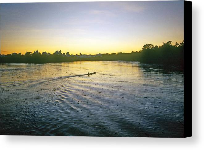 Amazon Canvas Print featuring the photograph Indian In Dugout Canoe by Buddy Mays
