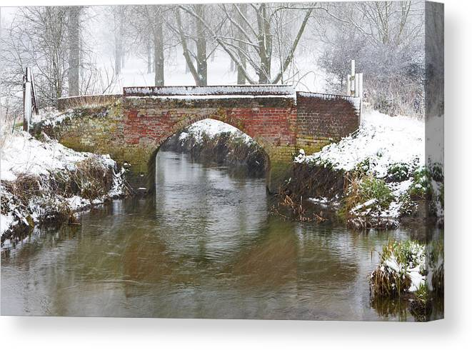 Ice Canvas Print featuring the photograph Bridge Over River In A Snowstorm by Fizzy Image