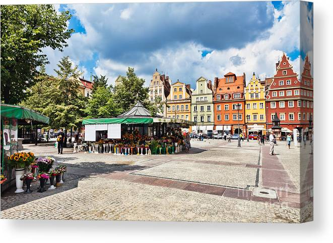 Poland Canvas Print featuring the photograph Flowers In Salt Square - Wroclaw Poland by Frank Bach