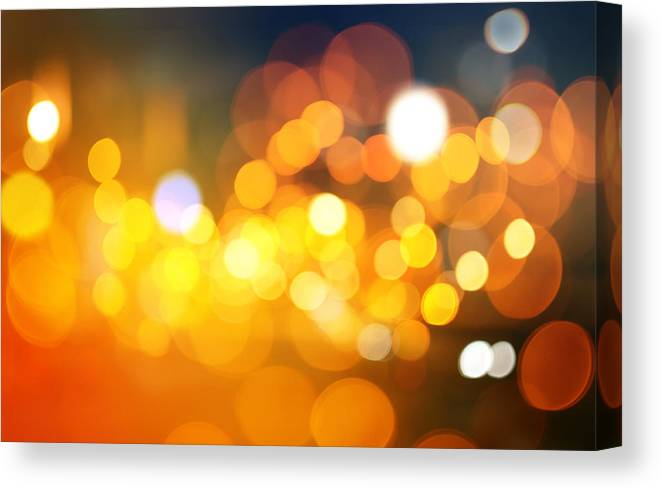 Abstract Canvas Print featuring the photograph Abstract Circular Bokeh Background Of Christmaslight by Nattapon Wongwean
