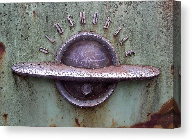 Car Canvas Print featuring the photograph Oldsmobile by Audrey Venute