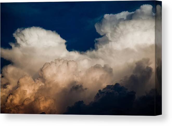 Clouds Canvas Print featuring the photograph Storm Front by Patrick Flynn