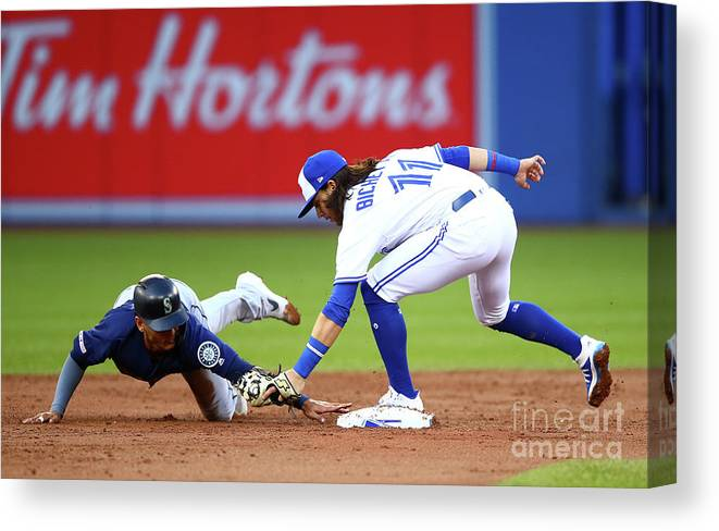 People Canvas Print featuring the photograph Seattle Mariners V Toronto Blue Jays by Vaughn Ridley