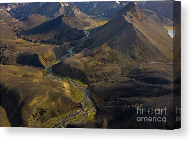 Iceland Canvas Print featuring the photograph Over Iceland Highlands Hills Of Rhyolite by Mike Reid