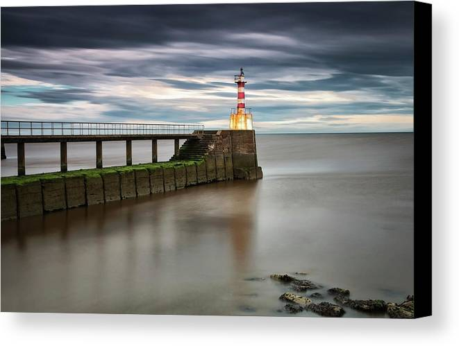 Tranquil Canvas Print featuring the photograph A Red And White Striped Lighthouse by John Short
