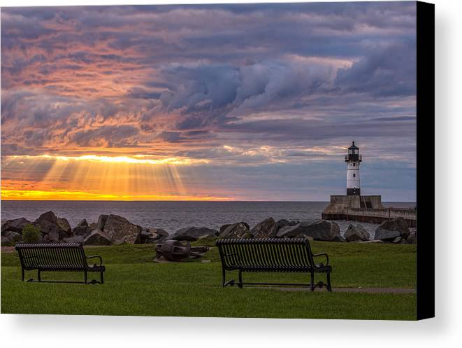 front Row Seats lake Superior canal Park canal Park Lighthouse duluth north Shore Sunrise Dawn Rays god Rays Clouds Benches Lighthouse great Lake Sunset Sunrays Magic Nature Summer perfect Duluth Day mary Amerman Canvas Print featuring the photograph Front Row Seats by Mary Amerman