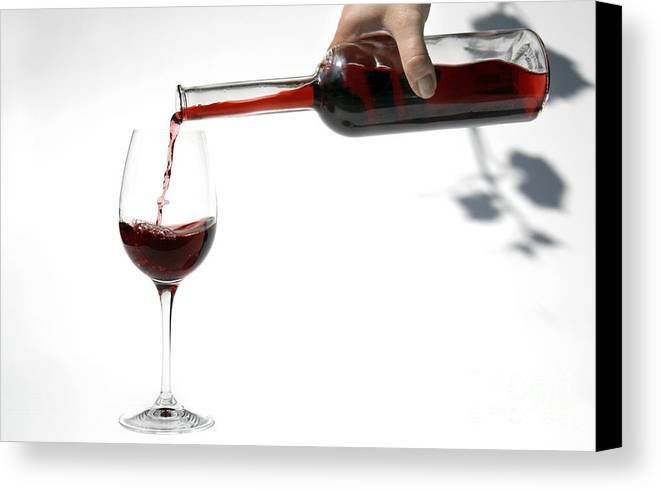 Alcohol Canvas Print featuring the photograph Pouring Red Wine Into Glass by Patricia Hofmeester