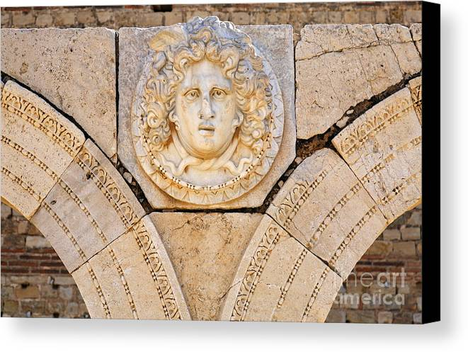 Libya Canvas Print featuring the photograph Sculpted Medusa Head At The Forum Of Severus At Leptis Magna In Libya by Robert Preston