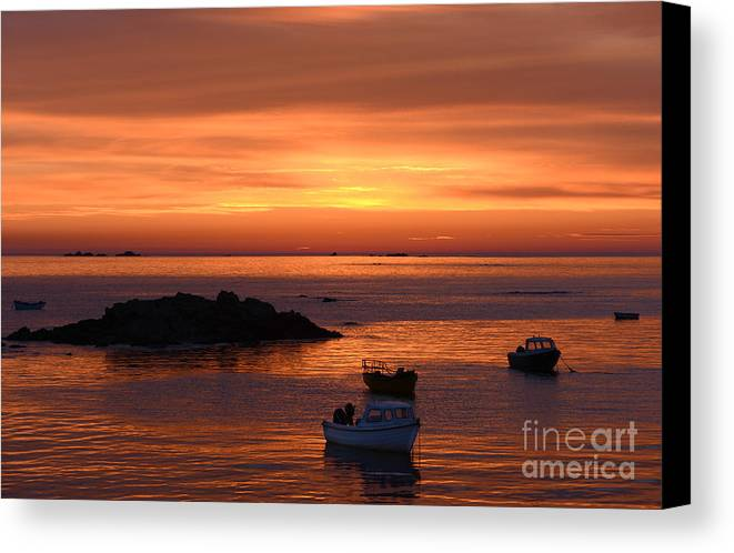 Sunset Guernsey Channel Islands Sunset Dusk Twilight Boats Rocquaine Bay Sea Coast Coastal Coastline Shore Shoreline Moored Fishing Orange Moody Relaxing Tranquil Idyllic Peaceful Calm Evening Night Setting Sun Canvas Print featuring the photograph Sundown In Guernsey by Rob Smith