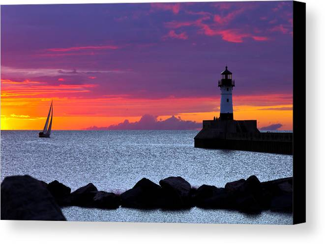 Sunrise lake Superior Sailing canal Park Lighthouse Duluth north Shore canal Park Lighthouse sail Boat Dawn Morning Magic Wow! Canvas Print featuring the photograph Sunrise Sailing by Mary Amerman