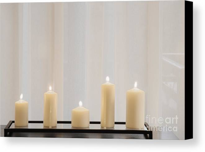 5 Canvas Print featuring the photograph Five White Lit Candles by Andersen Ross