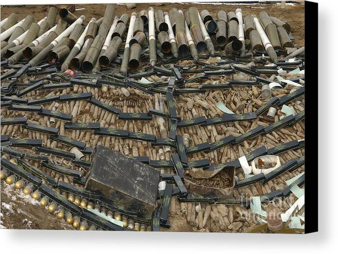 In A Row Canvas Print featuring the photograph Unexploded Ordnance Ready by Stocktrek Images