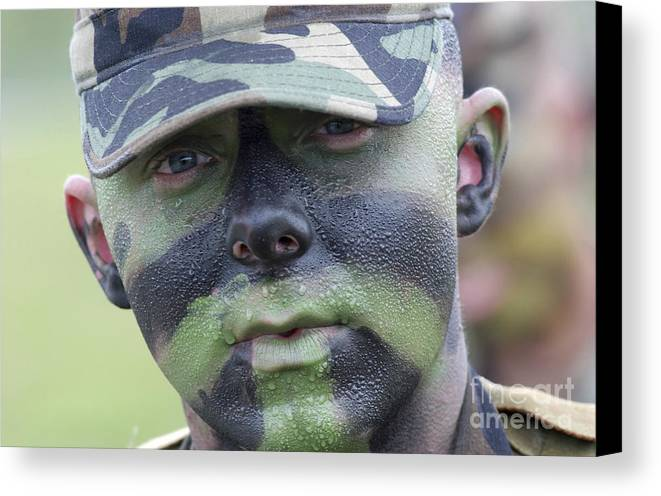 Beads Canvas Print featuring the photograph U.s. Army Soldier Wearing Camouflage by Stocktrek Images