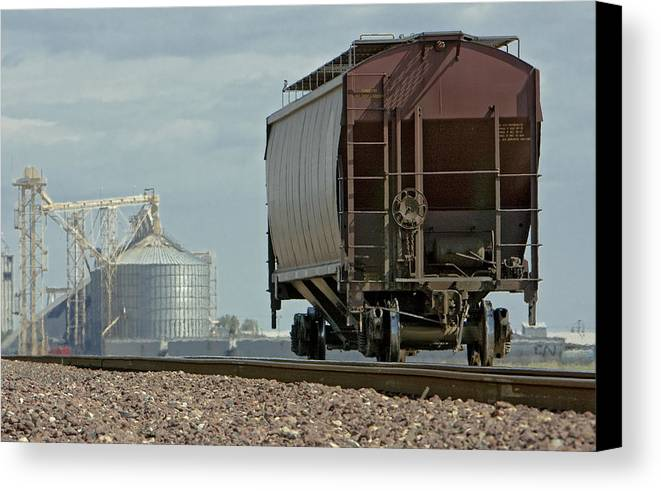 Cement Canvas Print featuring the photograph A Lone Grain Hopper Stands Idle On The Tracks by Mark Hendrickson