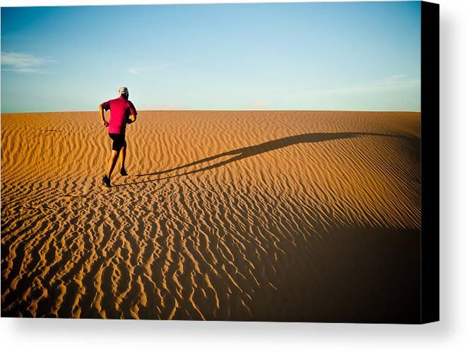 Running Canvas Print featuring the photograph A Long Desert Run by Scott Sawyer
